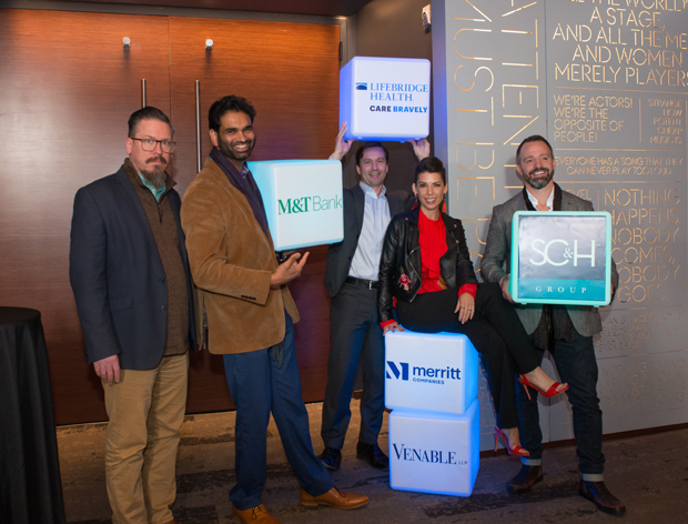 "From left, Shelly Blake-Plock, founder and CEO of Yet Analytics; Pritpal Kalsi, director at SC&H Group; Dr. Daniel Durand, chief innovation officer of LifeBridge Health; Nicole Casanova, CEO of Casanova Ventures; and Joe Mechlinski, CEO of SHIFT, pose for a photo with sponsor logos at the inaugural ""AdvantEdge: Leading on The Edge"" innovation summit. (Photo courtesy of SC&H Group)"