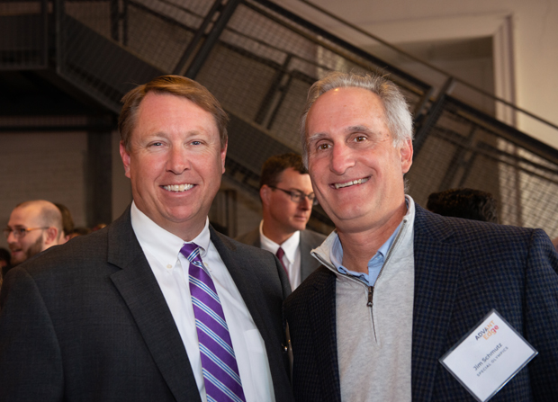 "Jamie Campbell, left, in leasing at Merrit Properties; and Jim Schmutz, president and CEO of Special Olympics, were on hand for the inaugural ""AdvantEdge: Leading on The Edge"" innovation summit. (Photo courtesy of SC&H Group)"
