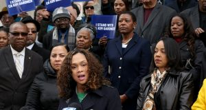 Baltimore State's Attorney Marilyn Mosby, center, speaks at a rally outside the Mel Carnahan Courthouse in St. Louis on Tuesday, Jan. 14, 2020, with several other African-American female prosecutors in support of Circuit Attorney Kimberly M. Gardner in her efforts to reform the criminal justice system and her suit against the St. Louis police union among others. Gardner has filed a federal civil rights lawsuit accusing the city, the local police union and others of a coordinated and racist conspiracy aimed at forcing her out of office. (Christian Gooden/St. Louis Post-Dispatch via AP)