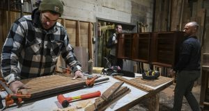James Battaglia, left, and Will Phillips, right, are co-owners of Sandtown Furniture Co. in Baltimore, which makes custom furniture out of wood from old buildings. (Washington Post/ Michael Robinson Chavez)