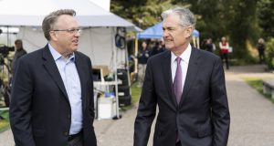 John Williams, left, president and CEO of the Federal Reserve Bank of New York, chats with Federal Reserve Chairman Jerome Powell Aug. 24, 2018, after Powell's speech at the Jackson Hole Economic Policy Symposium in Jackson Hole, Wyo. Williams said Thursday the Fed needs to reorient its policies toward fighting inflation that is too low, rather than its historic focus on keeping inflation from getting too high. (Johnathan Crosby/AP File)