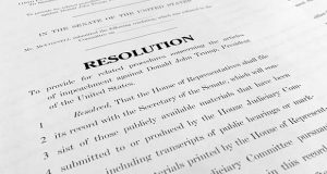 A copy of a Senate draft resolution to be offered by Senate Majority Leader Mitch McConnell, R-Ky., regarding the procedures during the impeachment trial of President Donald Trump in the U.S. Senate is photographed in Washington, Monday, Jan. 20, 2020. McConnell is proposing a condensed, two-day calendar for opening arguments in Trump's impeachment trial, ground rules that are raising objections from Democrats on the eve of the landmark proceedings. (AP Photo/Jon Elswick)