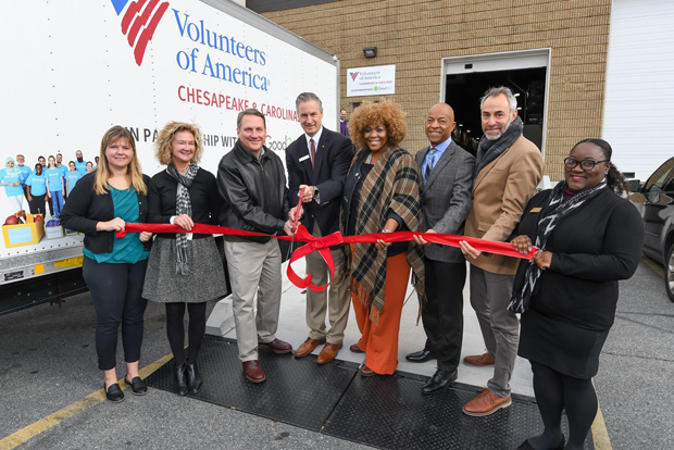 From left, Heather Campbell, field representative for the office of U.S. Sen. Ben Cardin, D-Md.; Mizi Bernard, chief of staff for Del. J. Sandy Bartlett, D-Anne Arundel; Matthew Connelly, CEO of Good360; Russell Snyder, CEO and president of Volunteers of America; Dr. Sharon Jones-Eversley, an associate professor at Towson University; Alvin Nichols, a board member with Volunteers of America Chesapeake & Carolinas; Stephen  Samuel, senior director of VOA; and Meshelle Johnson, constituent services representative with the office of U.S. Sen. Chris Van Hollen, D-Md., participate in a ribbon-cutting ceremony marking the opening of the new donation Resource Center for VOACC. (Photo courtesy of VOA Chesapeake & Carolinas)