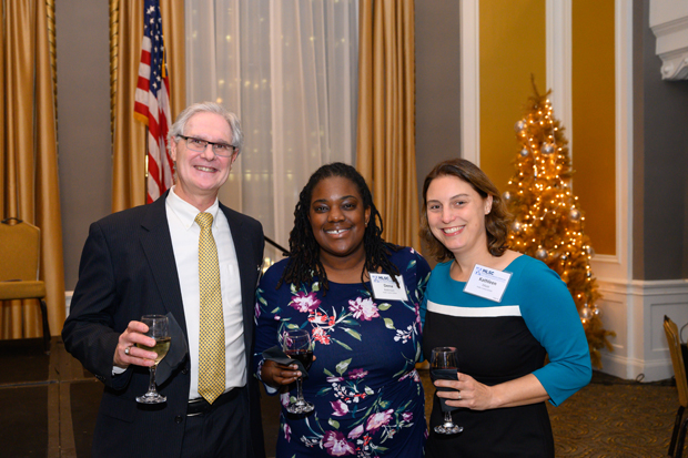 John Nethercut, left, executive director of the Public Justice Center, poses for a photo with colleagues Dena Robinson, Francis D. Murnaghan Jr. Appellate Advocacy Fellow, and Kathleen Elliott, director of development. (Photo by Guill Photo Inc.)