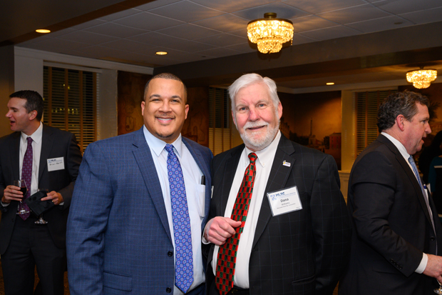 Sidney Butcher, left, associate judge with the District Court for Anne Arundel County and an MLSC board member, enjoys some time with Dana Williams, a partner with Heisler, Williams, & Lazzaro LLC and president of the Maryland State Bar Association. (Photo by Guill Photo Inc.)