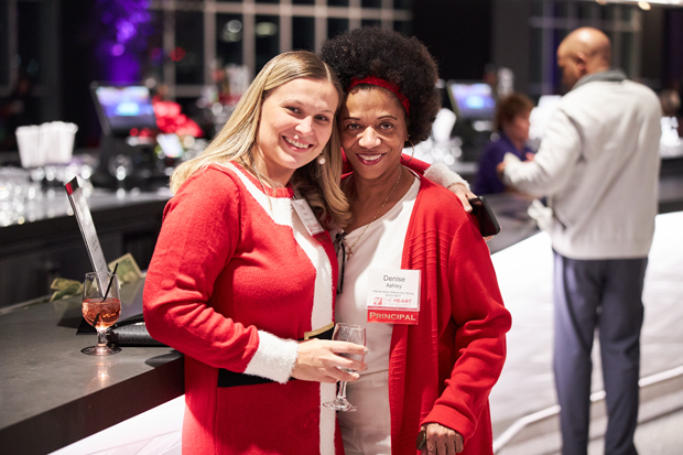 Olia Hardy, left, principal at William Paca Elementary School, enjoys a moment with Denish Ashley, the principal at Highlandtown Elementary/Middle School during the Heart of the School Holiday Party. (Photo courtesy of Fund for Educational Excellence)
