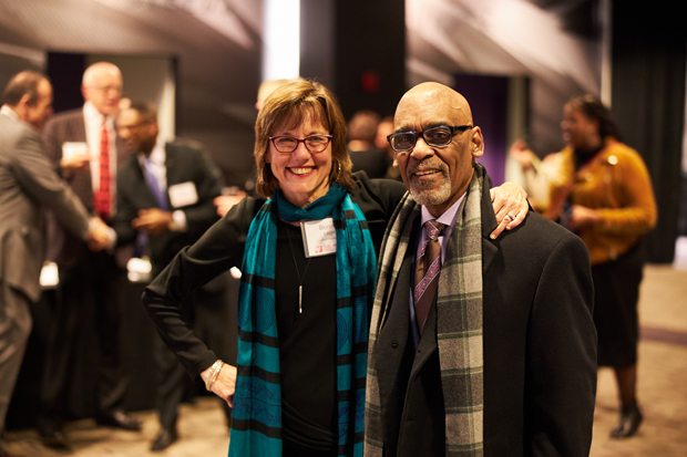 Bonnie Legro,  senior program officer in education with the Abell Foundation, chats with Jerome Jones, director, labor relations and negotiations with Baltimore City Public Schools. (Photo courtesy of Fund for Educational Excellence)
