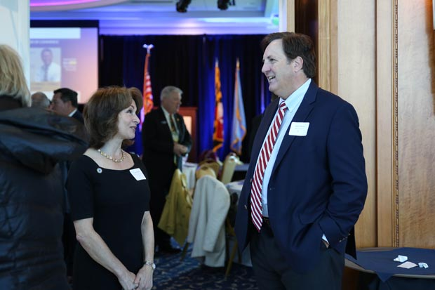 Cindy Mumby, Harford County's director of governmental and community relations, chats with James Martin, president of Ward Properties. (Photo by Sophia Joy Photography)