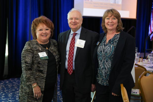 From left, Patrice Ricciardi, director of business development with Freedom Federal Credit Union and Harford Chamber of Commerce board chair; Philip Logan, executive vice president and director of strategic initiatives at Chesapeake Bank of Maryland; and Dawn Hamilton, vice president of product management with Freedom Federal Credit Union, attended the chamber's annual State of the County luncheon. (Photo by Sophia Joy Photography)