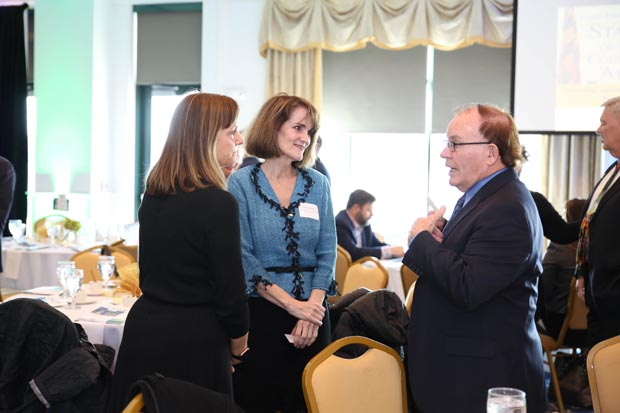 From left, Carolyn Evans, an attorney with the Law Offices of Anthony J. DiPaula, and Janet Garinther, a Realtor with Cummings & Co. Real Estate, chat with Micheal Leaf, a member with Pessin Katz Law P.A. (Photo by Sophia Joy Photography)