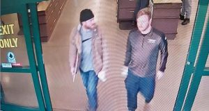 FILE - In this file image from a Jan. 1, 2020, surveillance video released by the U.S. Attorney's office in Maryland, Brian Mark Lemley Jr, right, and Patrik Mathews leave a store in Delaware where they purchased ammunition and paper shooting targets. The pair, along with William Garfield Bilbrough IV, were arrested in January and are accused of plotting to commit violence at a Virginia gun rights rally. Lemley and Bilbrough pleaded not guilty in Federal court in Greenbelt, Md., on Tuesday, Feb. 18, and Mathews was scheduled for arraignment later in the day. (U.S. Attorney via AP, File)
