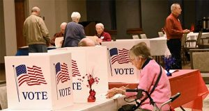Primary voting for the special election takes place, Tuesday, Feb. 4, 2020, at the Conference Center at the Charlestown Senior Living Community, in Baltimore. (Jeffrey F. Bill/The Baltimore Sun via AP)