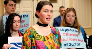 Kallan Benson, a student activist and a leader of Fridays for Future, speaks in support of legislation in Maryland to reduce greenhouse emissions statewide by 60% by 2030 during a news conference on Wednesday, Feb. 19, 2020, in Annapolis, Md. (AP Photo/Brian Witte)