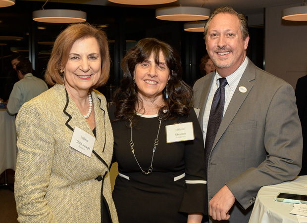 From left, Maryland Court of Appeals Chief Judge Mary Ellen Barbera, Pro Bono Resource Center Executive Director Sharon E. Goldsmith and Maryland State Bar Association President-elect Mark Scurti, judge of the District Court of Maryland for Baltimore City, pose for a photo. (Photo by Coos Hamburger/Focophoto)