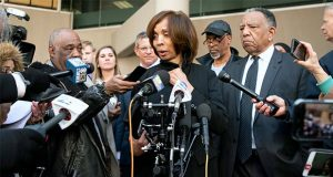 Former Baltimore mayor Catherine Pugh speaks to reporters after her sentencing hearing at U.S. District Court in Baltimore on Thursday, Feb. 27, 2020. Pugh was sentenced to three years in federal prison for arranging fraudulent sales of her self-published children's books to nonprofits and foundations to promote her political career. (AP Photo/Steve Ruark)