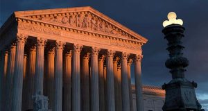 FILE - In this Jan. 24, 2019 file photo, the Supreme Court is seen at sunset in Washington. The Supreme Court is ruling 5-4 to close the courthouse door on the parents of a Mexican teenager who was shot dead over the border by an American agent. The court's five conservative justices ruled Tuesday that the parents could not sue Border Patrol Agent Jesus Mesa Jr., who killed their unarmed 15-year-old son in 2010.  (AP Photo/J. Scott Applewhite)
