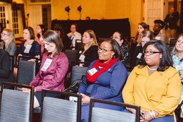 The crowd at the Governor Calvert House in Annapolis listens during the panel discussion at the Women Who Lead event. (Photo by Brooke Jackson)