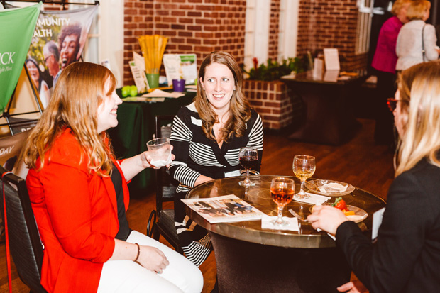 Several people enjoy networking prior to the panel discussion at the Women Who Lead event. (Photo by Brooke Jackson)