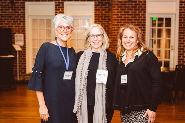 From left, Jacquie Cohen Roth, founder and CEO of CannabizMD LLC; Elizabeth Weglein, CEO of Elizabeth Cooney Care Network; and Ardys Ryssakis, senior strategist for BTU and anchor initiatives with Towson University, pose for a photo during the event. (Photo by Brooke Jackson)