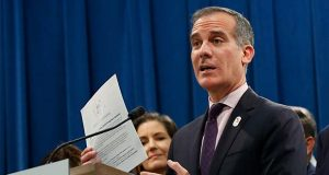 FILE - In this Monday, March 9, 2020, file photo, Los Angeles Mayor Eric Garcetti speaks at a news conference at the Capitol in Sacramento, Calif. In Los Angeles, Garcetti has instituted a shutdown on a city of nearly 4 million people and threatened uncooperative business owners with power shutoffs and arrest amid the new coronavirus pandemic. (AP Photo/Rich Pedroncelli, File)