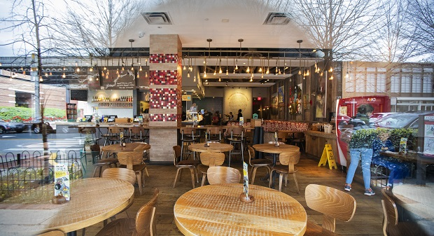 A downtown Bethesda restaurant is closed as Maryland Gov. Larry Hogan's executive order took effect earlier this month. Restaurants are still allowed to have carryout, delivery and drive-thru services. (AP Photo/Manuel Balce Ceneta)