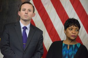Senate President Bill Ferguson and House Speaker Adrienne Jones were grim-faced at Gov. Larry Hogan's news conference on COVID-19 Thursday. (The Daily Record/Bryan P. Sears)