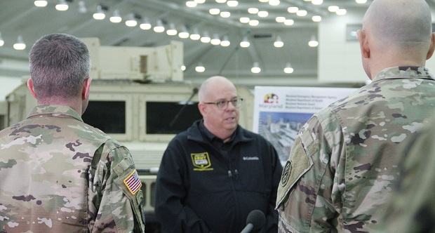 Gov. Larry Hogan is briefed by the Maryland National Guard on efforts to convert part of the Baltimore Convention Center to hospital space to respond to the coronavirus epidemic. (The Daily Record/Adam Bednar)