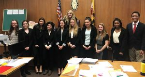 The Bryn Mawr mock trial, team, left, and Baltimore City College mock trial teams. (The Daily Record / Louis Krauss)