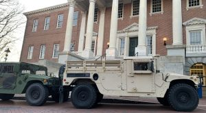 State military vehicles are parked outside the State House complex Monday morning. (The Daily Record/Bryan P. Sears)