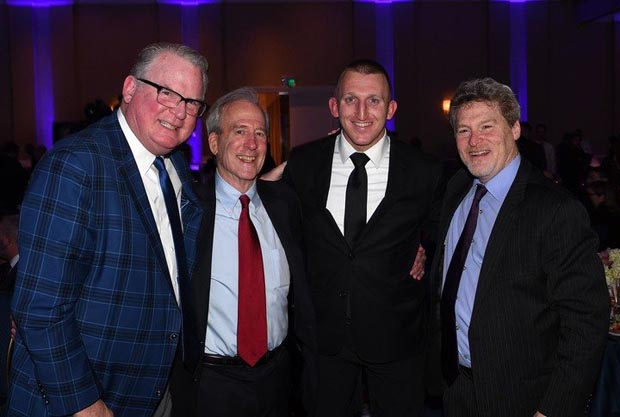 From left, Cal Ripken Sr. Foundation board member Warren Bischoff, board chairman Harold Himmelman, honoree Rob Jones and foundation President and CEO Steve Salem gather for a photo. (Photo by Robert Smith Photography)