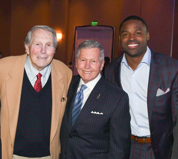 From left, Baseball Hall of Famer Brooks Robinson, Longtime University of Maryland broadcaster Johnny Holiday and former Baltimore Ravens wide receiver Torrey Smith gather for a photo at the gala. Robinson was also the emcee for the evening's festivities. (Photo by Robert Smith Photography)
