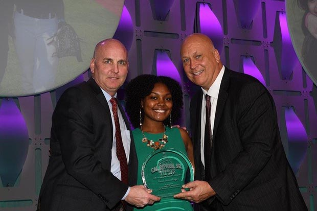 Merit Scholar Award winner Venus Simone Rogers accepts her award from Bill Ripken and Cal Ripken Jr. during the 16th annual Aspire Gala at the Baltimore Marriott Waterfront hotel. (Photo by Robert Smith Photography)