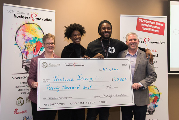 Nichelle Roane & Todd Sheridan of TreeHouse Juicery LLC, center, receive a ceremonial check for $20,000 for winning the seventh annual Business Plan Competition, hosted by the Community College of Baltimore County's Center for Business Innovation. Presenting the check were Carlene M. Cassidy, far left, CEO of the Philip E. and Carole R. Ratcliffe Foundation, and Dennis Sullivan, executive director of the CCBC Center for Business Innovation. (Photo courtesy of Community College of Baltimore County)