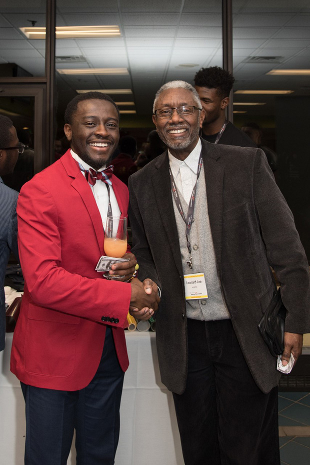Finalist Kofi Osei-Tutu, left, spends time with mentor Leonard Lee, a small business adviser/consultant with the Small Business Resource Center of the Baltimore County Chamber of Commerce. (Photo courtesy of Community College of Baltimore County)