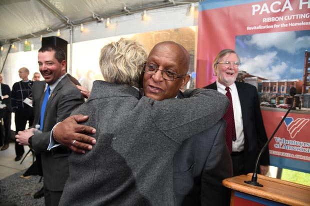 "Baltimore City Mayor Bernard C. ""Jack"" Young gets a hug from Nancy Hoff, a principal with Somerset Development. (Photo by Maximilian Franz)"