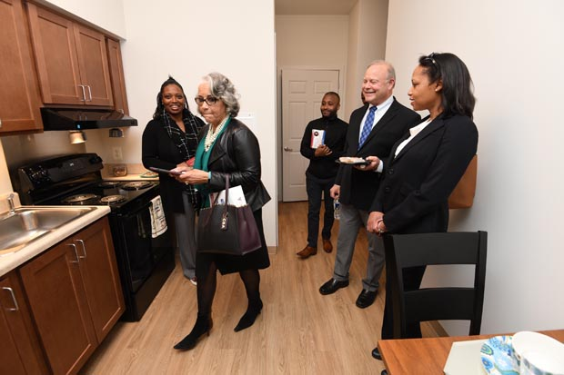 Event attendees take a tour of an apartment unit at Paca House, which underwent a $26.8 million renovation. (Photo by Maximilian Franz)