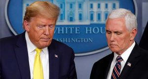 President Donald Trump steps from the podium to allow Vice President Mike Pence to speak in the briefing room of the White House in Washington, Monday, March, 9, 2020, about the coronavirus outbreak. (AP Photo/Carolyn Kaster)