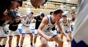 Yeshiva University Maccabees huddle around guard Ryan Turell (11) before a game against the U.S. Merchant Marine Academy (USMMA), in New York, Feb. 25, 2020. The Maccabees won the Skyline Conference quarterfinal 75-57. (AP Photo/Jessie Wardarski)