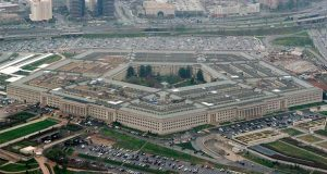 "FILE - This March 27, 2008, aerial file photo, shows the Pentagon in Washington.  The Pentagon is reconsidering its awarding of a major cloud computing contract to Microsoft after rival tech giant Amazon protested what it called a flawed bidding process. U.S. government lawyers said in a court filing this week of March 13, 2020  that the Defense Department ""wishes to reconsider its award decision"" and take another look at how it evaluated technical aspects of the companies' proposals to run the $10 billion computing project. (AP Photo/Charles Dharapak, File)"
