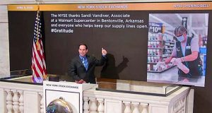 In this photo taken from video provided by the New York Stock Exchange, Kevin McSpedon, Assistant Chief Electrician, rings the opening bell at the NYSE, recognizing Sandi Vandiver, associate at a Walmart Supercenter in Bentonville, Arkansas, Wednesday, April 8, 2020. (New York Stock Exchange via AP)