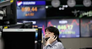 A currency trader watches computer monitors at the foreign exchange dealing room in Seoul, South Korea, Thursday, April 16, 2020. Asian stocks were mostly lower Thursday after unexpectedly weak U.S. retail and other data added to gloom about the impact of the coronavirus pandemic. (AP Photo/Lee Jin-man)