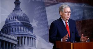 Senate Majority Leader Mitch McConnell of Ky., speaks with reporters after the Senate approved a nearly $500 billion coronavirus aid bill, Tuesday, April 21, 2020, on Capitol Hill in Washington. (AP Photo/Patrick Semansky)