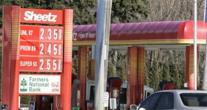 """Traffic drives past a sign for a Sheetz gasoline station and convenience store in Butler, Pa., Friday, Feb. 23, 2007. A convenience store that was allowed to sell takeout beer after walling off its restaurant from the rest of the business was forced to suspend suds sales Friday after losing a court decision. The court said the """"retail dispenser"""" license that the Pennsylvania Liquor Control Board issued for an Altoona, Pa. Sheetz requires at least some of the beer sold there to be consumed on the premises. Sheetz, however, had no intention of letting customers drink in its stores. (AP Photo/Keith Srakocic)"""