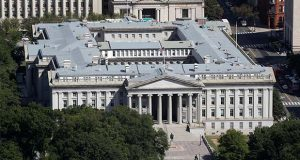 This Sept. 18, 2019 photo shows the U.S. Treasury Department building viewed from the Washington Monument in Washington. The Treasury Department says it will need to borrow a record $2.99 trillion during the current April-June quarter to cover the cost of various rescue efforts dealing with the coronavirus pandemic. Treasury said Monday, May 4, 2020 that the $2.99 trillion it plans to borrow this quarter will far surpass the $530 billion quarterly borrowing it did in the July-September 2008 quarter as it dealt with the 2008 financial crisis. The extraordinary sum of $2.99 trillion of borrowing in a single quarter dwarfs the $1.28 trillion the government borrowed in the bond market for all of 2019. (AP Photo/Patrick Semansky)