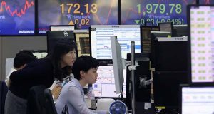 Currency traders watch monitors at the foreign exchange dealing room of the KEB Hana Bank headquarters in Seoul, South Korea, Wednesday, May 20, 2020. Asian shares were mixed Wednesday as market players waffled between hopes for recovery as economies gradually reopen and worries over the havoc wreaked by the pandemic.(AP Photo/Ahn Young-joon)