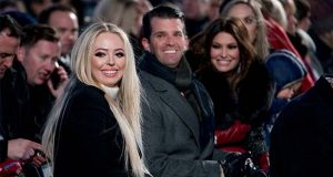 """FILE - In this Nov. 28, 2018, file photo from left, Tiffany Trump, the daughter of President Donald Trump, Donald Trump Jr. and Kimberly Guilfoyle, arrive ahead of President Donald Trump and first lady Melania Trump at the National Christmas Tree lighting ceremony at the Ellipse near the White House in Washington. Tiffany, recently graduated from Georgetown Law School. """"Just what I need is a lawyer in the family. Proud of you Tiff!"""" President Donald Trump said Wednesday, May 20, 2020, in acongratulatory tweet. (AP Photo/Andrew Harnik, File)"""