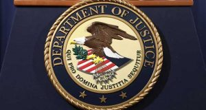 The U.S. Department of Justice seal is displayed on a podium following a news conference