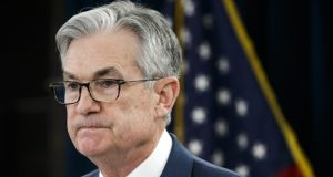 """FILE - In this March 3, 2020, file photo, Federal Reserve Chair Jerome Powell pauses during a news conference, to discuss an announcement from the Federal Open Market Committee, in Washington. Efforts to forecast the U.S. economy's path to recovery from the current deep downturn face """"a whole new level of uncertainty,"""" Federal Reserve Chairman Jerome Powell said Thursday, May 21. (AP Photo/Jacquelyn Martin, File)"""