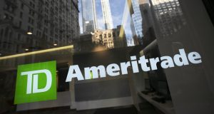 FILE - In this Nov. 25, 2019, file photo a sign for TD Ameritrade is shown on an office window for the brokerage in New York. The lure of snapping up stocks at bargain prices has been too strong to pass up for many people, even as uncertainty over the coronavirus pandemic clouds the market and global economic outlook. Stuck at home, but armed with online trading apps, individual investors helped drive the historic comeback for stocks since late March 2020.  (AP Photo/Mark Lennihan, File)