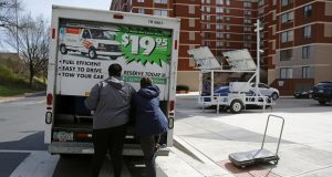 Howard University students  finish loading belongings into a U-Haul truck as they move out of their dorm in Washington, Wednesday, March 18, 2020. (AP Photo/Patrick Semansky)